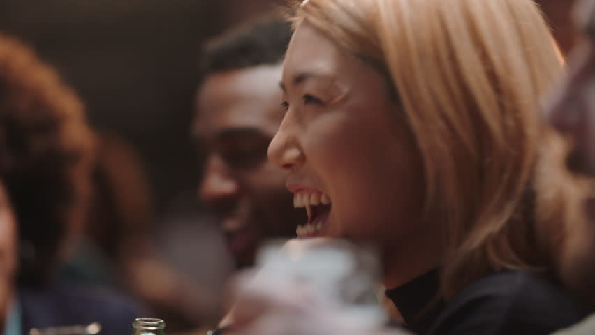 Beautiful asian woman hanging out with friends in restaurant laughing enjoying conversation socializing at party gathering | Shutterstock HD Video #1024763405