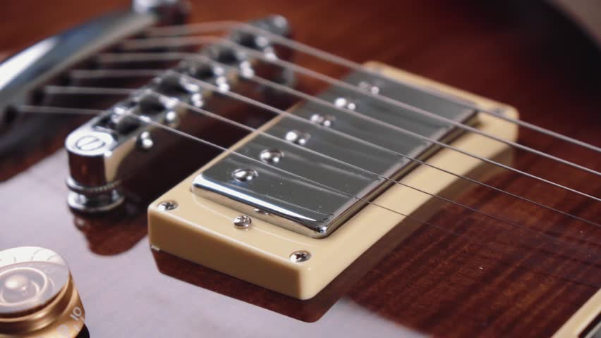 Electric guitar strings and body close up. Classical style rock music instrument | Shutterstock HD Video #1024773485