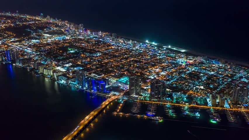 MIAMI, FLORIDA, USA - JANUARY 2019: Aerial hyperlapse 4k drone panorama view flight over Miami at night. Roads and streets from above.