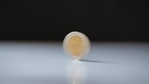 money coin rotating and spinning on white table. business economy finance concept. motion 4k b-roll footage