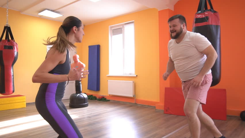 A man and a girl warm up in the gym before training in sports boxing, slow motion, knock-up | Shutterstock HD Video #1024882865