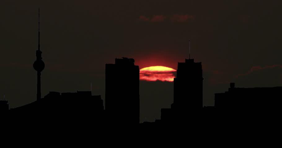 Berlin, Germany Radio Tower and Skyline Silhouette at Big Sun Sunrise Sunset Timelapse
