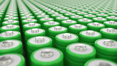 Electricity storage concept. Big field of green AAA batteries. Green energy concept
