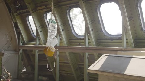 The old oxygen mask on the plane cabine. Handheld shot with selective focus. Catastrophe,airplane crash and