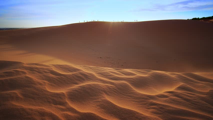 Strong wind in the desert, white sand dunes in Mui Ne, Vietnam. #1025306045