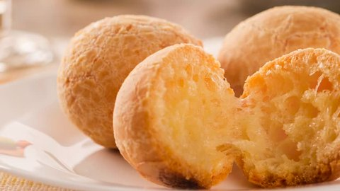 Slide shot Brazilian cheese buns . Table cafe in the morning with cheese bread.4K footage.