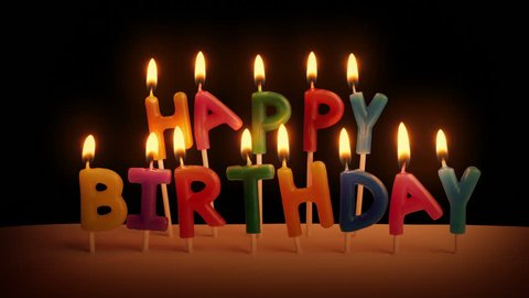 Happy Birthday Candles On Cake In The Dark