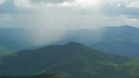 A rain shower moves across the peaks of the Appalachian mountains as seen from the Brasstown Bald visitors center in Georgia.