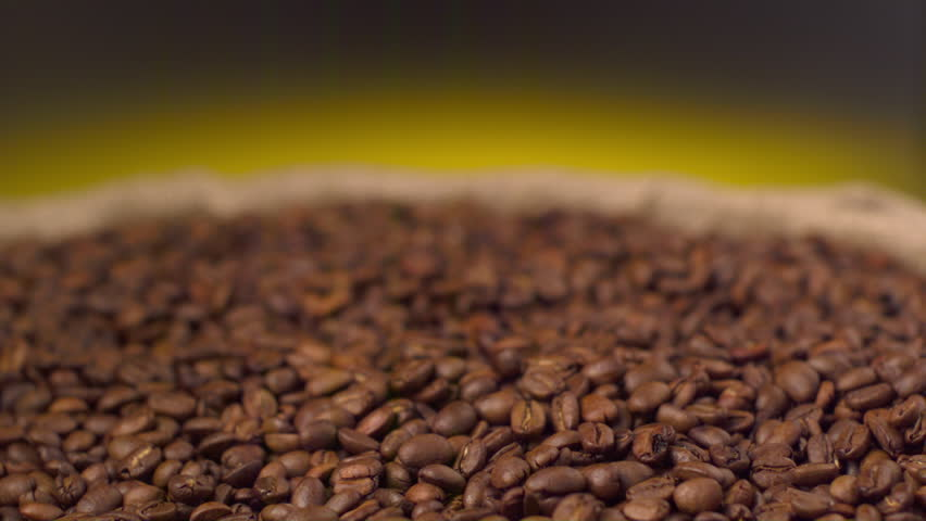 Shovel takes out coffee beans from pile  | Shutterstock HD Video #1025387705