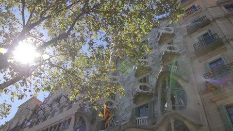 Outdoor view with sun blik Gaudi's creation-house Casa Batlo. The building that is now Casa Batllo was built in 1877 by Antoni Gaudi. Barcelona, spain
