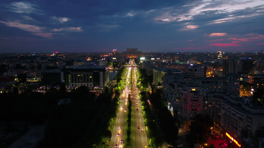 Aerial Romania Bucharest June 2018 Night 30mm 4K. Aerial video of downtown Bucharest in Romania at night