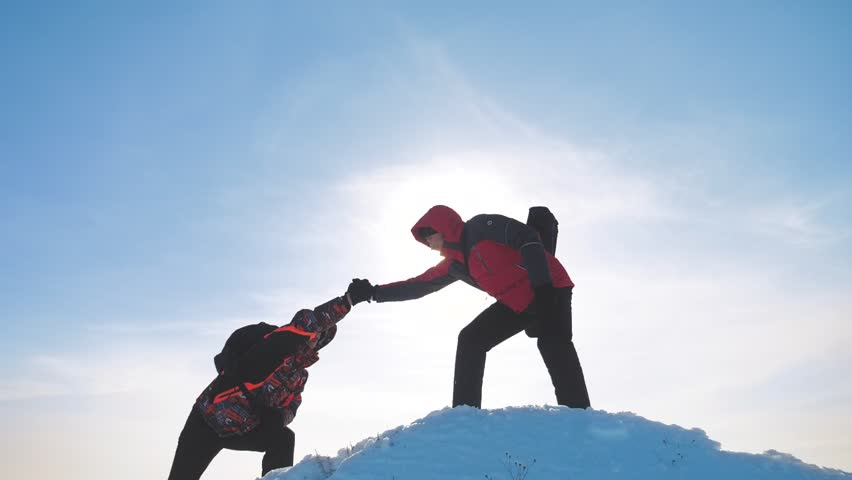 Teamwork business concept victory help hands arm slow motion video. team group tourist hikers gives a helping hand. success win winter reached the top of the mountain. tourists climbers climb to the | Shutterstock HD Video #1025595425
