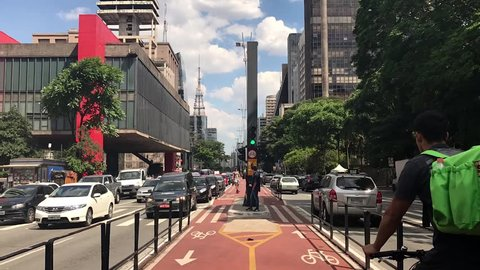 Sao Paulo, Brazil - March 5, 2019: Car traffic at rush hour on Paulista Avenue near MASP and Trianon Park, Sao Paulo city. Time lapse.
