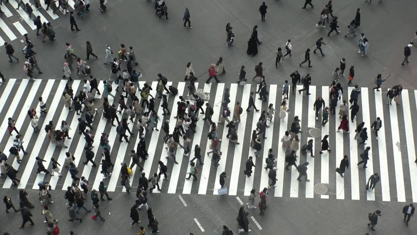 SHIBUYA,  TOKYO,  JAPAN - CIRCA MARCH 2019 : Aerial view around SHIBUYA scramble crossing.  Busy crowded area in Tokyo.  Wide view slow motion shot.