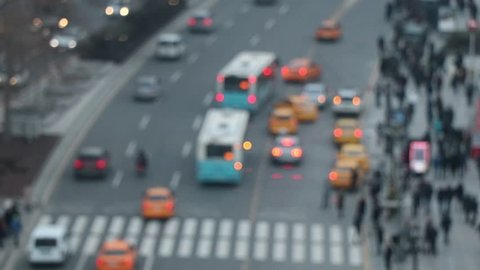 People walking crowded street women and men are stepping on the street. Traffic blurred Heavy vehicle traffic on the highway slowly moving car Turkey Europe Big City.