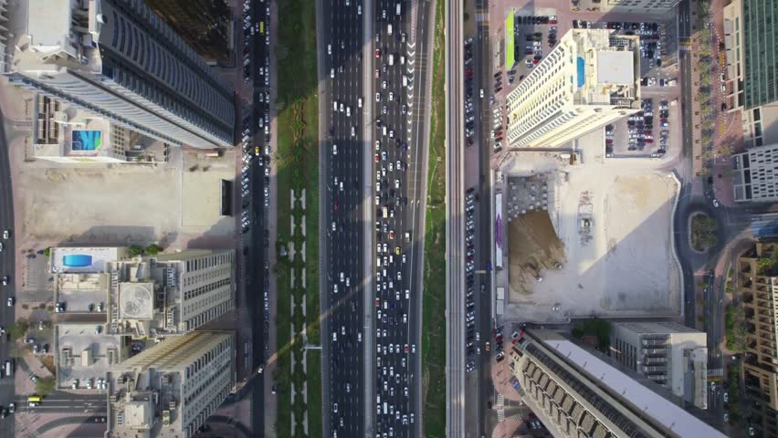 Long highway road and modern tall buildings in stunning futuristic big city Dubai top aerial panorama | Shutterstock HD Video #1025704775