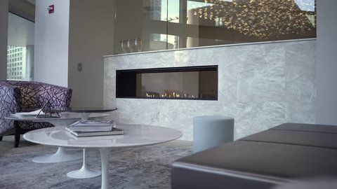 Chicago Illinois/United States- February 24th 2019: Interior of an upscale lobby in a downtown Chicago apartment complex.  marble walls fire place. the furniture is modern with stylish designs.