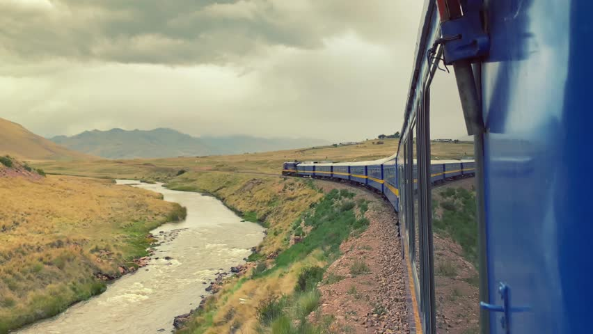 Titicaca train travelling through the Andes mountains in high altitude from Puno to Cusco. Peru, South America.