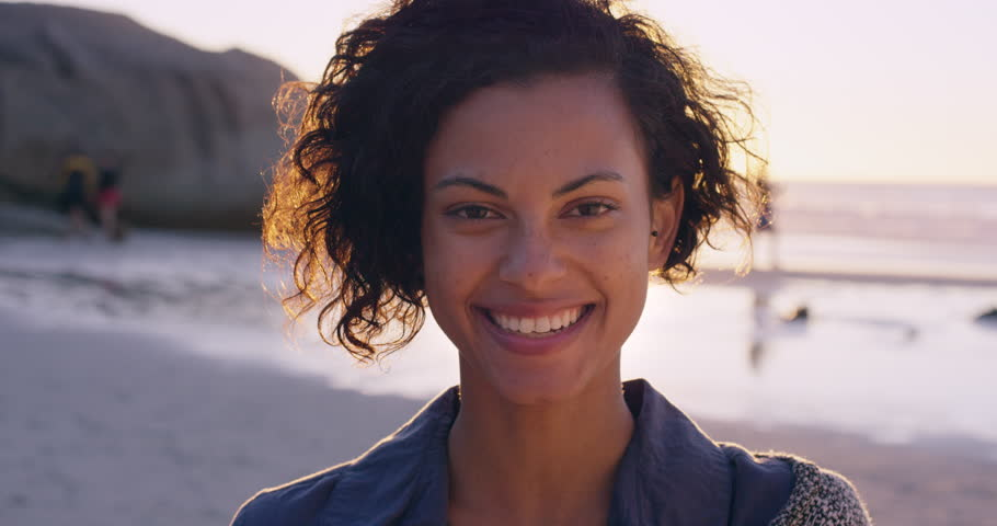 Portrait of beautiful girl smiling on beach at sunset in slow motion RED DRAGON