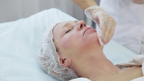 Resurfacing facial skin with a laser. Modern innovative medical equipment. laser face polishing in a cosmetology clinic