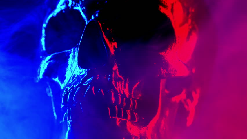 Ancient human skull head rotating in smoke close-up. Neon turquoise and red light. Spooky and sinister. Glamour, disco, halloween concept | Shutterstock HD Video #1025811695