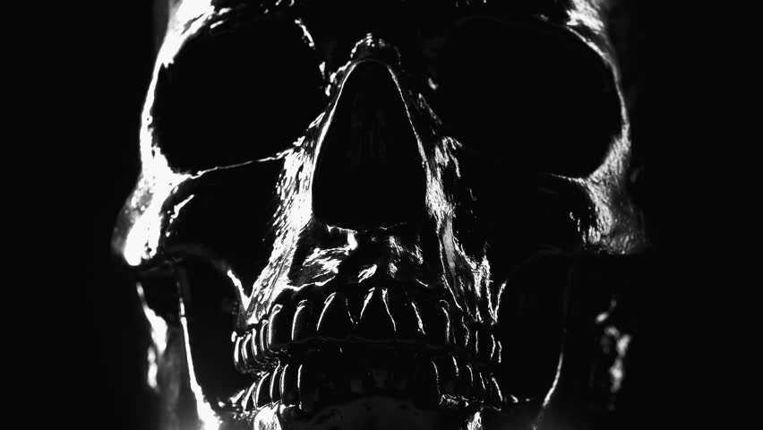 Model of human skull painted with black on dark background with variable illumination. Concept of fear and horror, Halloween celebration | Shutterstock HD Video #1025811755