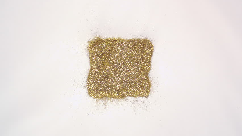 Square shaped gold glitter exploding towards camera and becoming defocused, shining bokeh