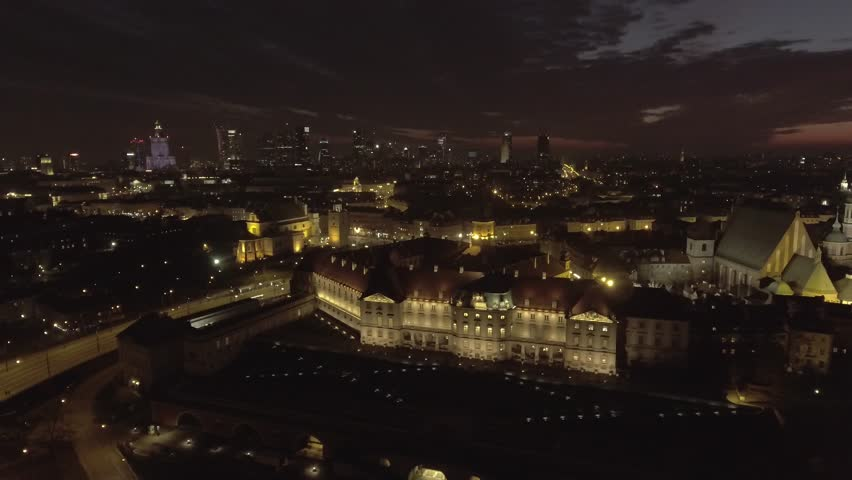 Aerial view of the buildings of the old city of Warsaw at night. royal palace and rooftops old buildings. Taken from the drone in RAW Format. 4K. | Shutterstock HD Video #1025861345