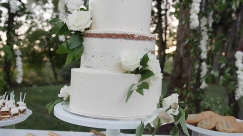 Wedding cake white flowers with greenery garden in background