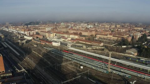 Bologna Centrale railroad station and tracks and city, Italy. Aerial shot