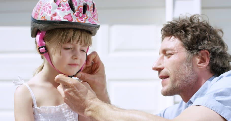 Father teaching daughter how to ride a bicycle slow motion RED DRAGON | Shutterstock HD Video #10258991