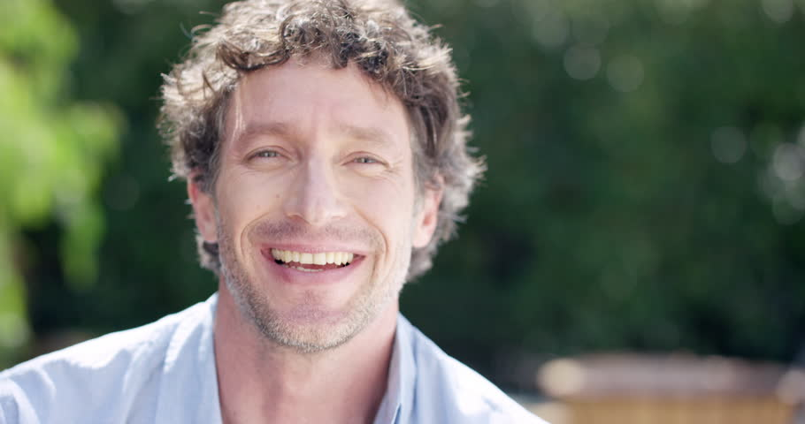 Close up of Attractive Mature man smiling portrait slow motion RED DRAGON | Shutterstock HD Video #10259024