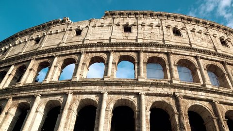 Coliseum of Rome - ancient amphitheatre in the centre of the city of Rome against a blue sky on a sunny day, Italy