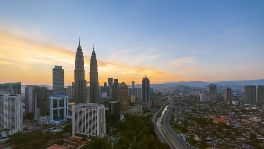 Aerial time lapse view of a city skyline with busy streets and expressway of  Malaysia at sunrise from twilight to day.   | Shutterstock HD Video #1025955095