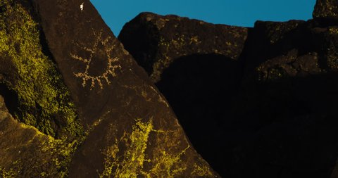 Petroglyph / Rock Art. Half-sun petroglyph with the rising moon in the background.  Black Mountain Rock Art District