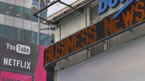 NEW YORK CITY - SEPTEMBER 2016: Dow Jones news ticker at the corner of 42nd street and Broadway in New York City, USA.