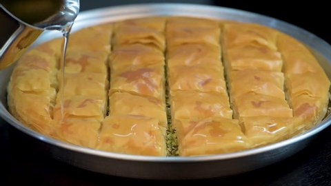 Baklawa or Baklava, adding sugar honey to it before serving