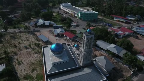 Aerial view point of interest of a Mosque, under construction in Penaga, Penang, Malaysia during daylight, October 2017. A very beautiful Mosque with blue dome for Muslims to perform their prayers.