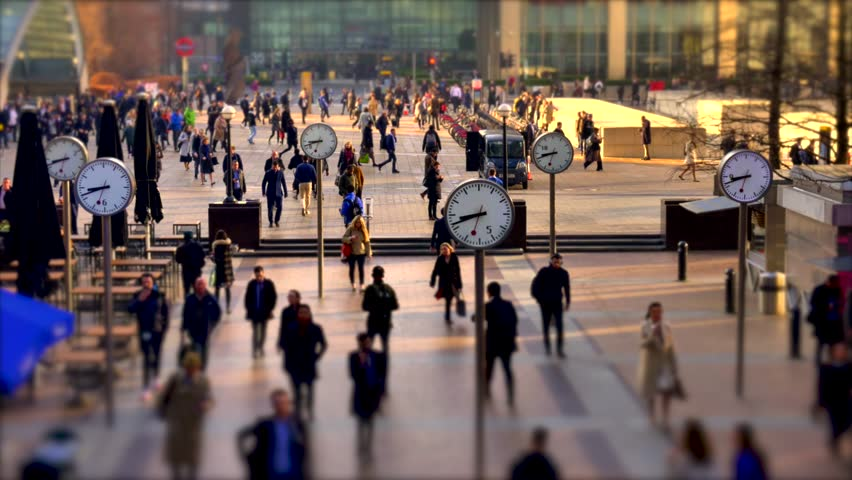 Motion lapse of Business Men and women at Canary Wharf durning morning rush hour, with large analog clocks spinning fast, Time and business concept. | Shutterstock HD Video #1026199085