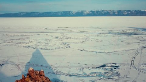 Separate stone cliff near the coast of Olkhon Island. Lake Baikal. Siberian spring, early morning