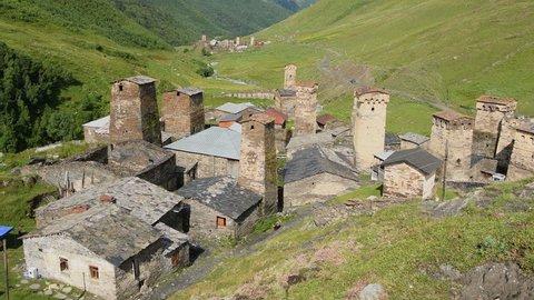 Zoom out: of the stone medieval fortified Svaneti tower houses of  Ushguli, Upper Svaneti, Samegrelo-Zemo Svaneti, Mestia, Georgia.