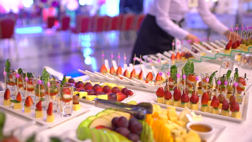 Beautifully decorated catering banquet table with snack canape in restaurant or hotel. catering service bisiness waiter buffet food set in event celebratoin corporate birthday kids party or wedding | Shutterstock HD Video #1026347945