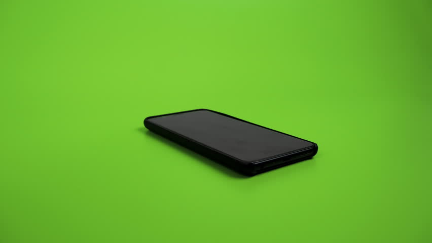 Falling, dropping smart phone. Green screen.  | Shutterstock HD Video #1026363995