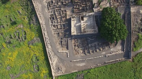 Top view on ruins of Capernaum Village and Octogonal Church of St. Peter. Sea of Galilee. Israel.