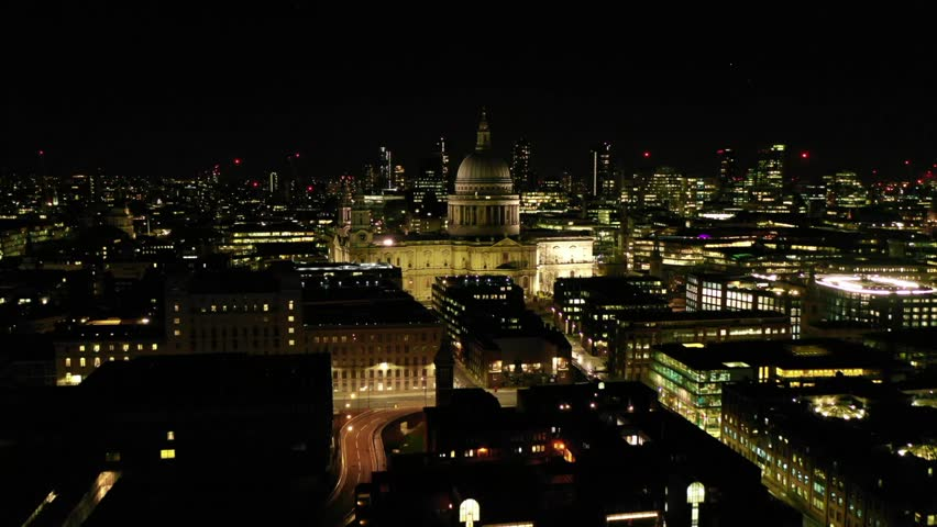Aerial drone night video of iconic Saint Paul landmark Cathedral in the heart of City financial district of London, United Kingdom | Shutterstock HD Video #1026441455
