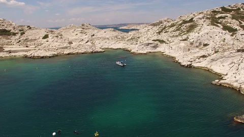 Aerial view by drone of rocky islands in the Mediterranean Sea with boats around, Marseille, France