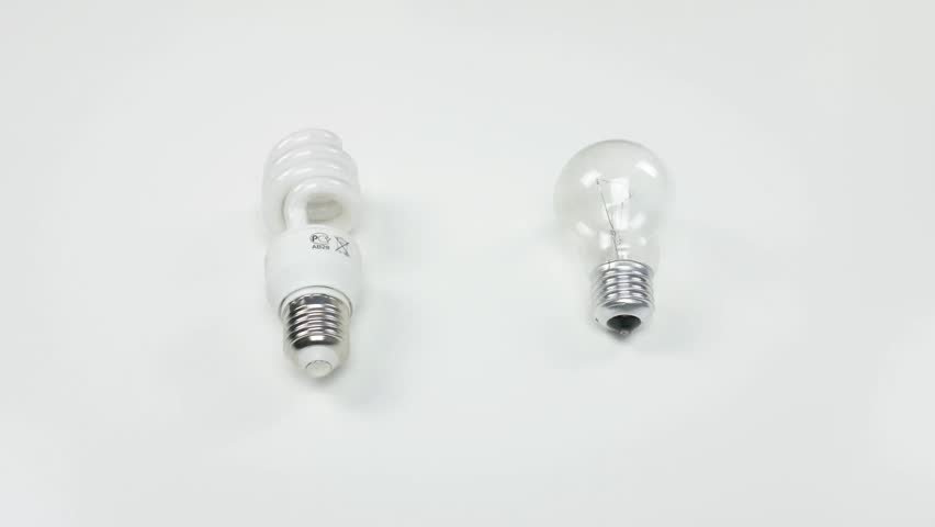 Male hands choose between energy saving light bulb and ordinary light bulb. | Shutterstock HD Video #1026508505