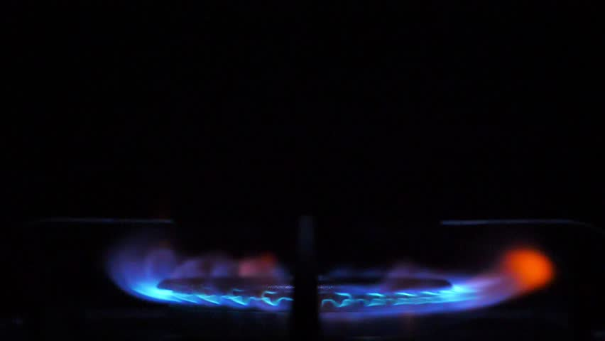 Kitchen burner flaming in the night, closeup. Nobody | Shutterstock HD Video #1026528095