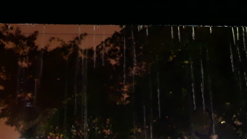 Raining in tropical country ,water from roof dropping down ,low angle view. Rain drops from the roof  | Shutterstock HD Video #1026643745