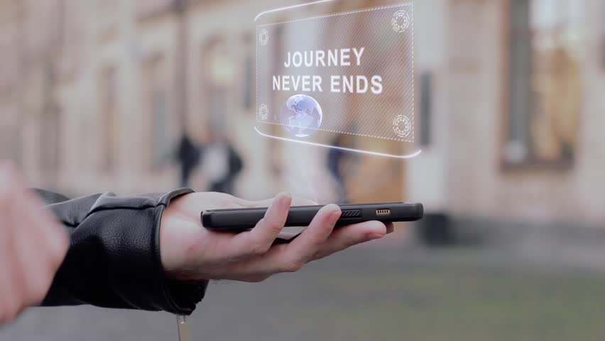 Male hands show on smartphone conceptual HUD hologram Journey never ends. Man with the future technology mobile holographic screen on blurred background of the university   Shutterstock HD Video #1026711545